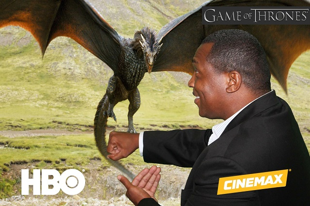 Man standing against a green screen background of Drogon from Game of Thrones