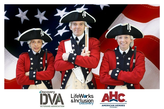 Three marching band members standing against a green screen background of the American flag