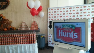 Branded TapSnap photo booth with Hunts logo