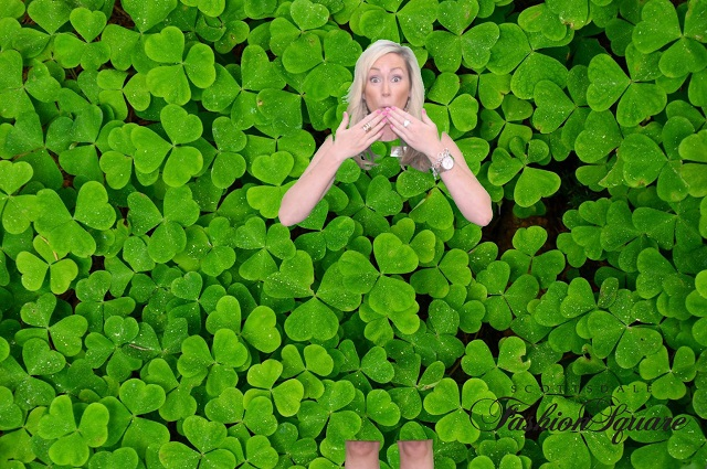 Woman's dress blending into a green screen background of clovers