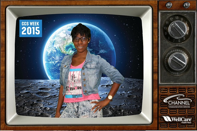 Woman on TV is standing on the moon with Earth in the background!
